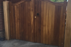 serpentine-gates-teak-oiled-front