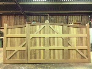 Serpentine Iroko gates unequal pair Back